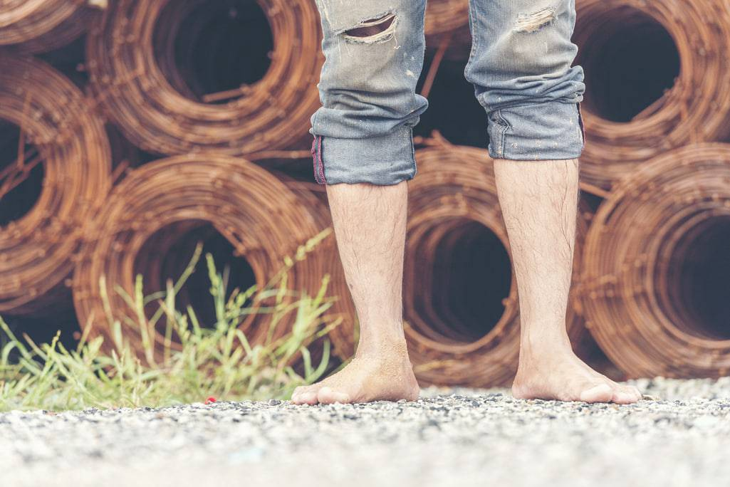 man barefoot walking